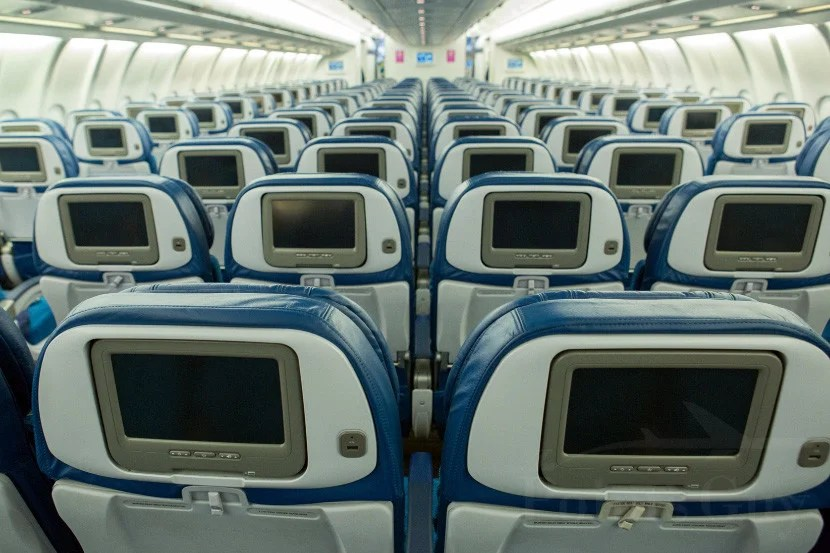 Economy seats offer on-demand in-flight entertainment.