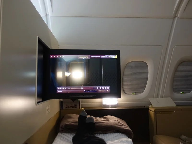 The screen swings out so you can watch it from bed.