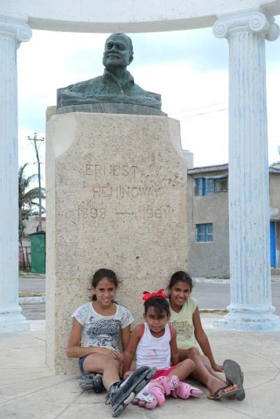 These kids were all smiles as our big group of American tourists approached the Hemingway bust.