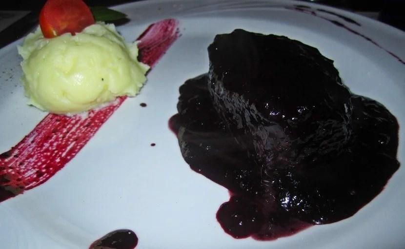 <em>Filetto al mirtillo,</em> steak drenched in bilberry sauce.