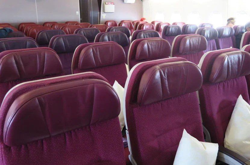 The rear economy cabin has some rows of differently colored seats.