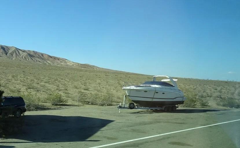 Strange sights abound, like a desert boat.