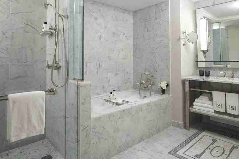 Marble bathrooms at The Surrey feel monumental. Image courtesy of The Surrey.