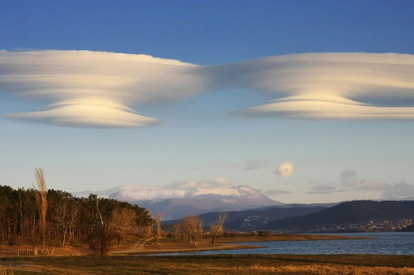 """Standing Lenticular clouds, which can often indicate areas of mountain waves. Image courtesy of <a href=""""http://www.shutterstock.com/pic-109452947/stock-photo-lenticular-clouds.html?src=9om4HidtjxtBX1Z4LxT1yQ-1-3"""" target=""""_blank"""">Shutterstock</a>."""
