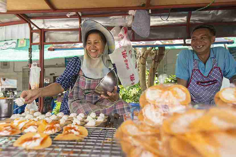 """Cooking up a storm at Chatuchak. Image courtesy of Chaiyaporn Baokaew for <a href=""""http://www.shutterstock.com/gallery-2570647p1.html?cr=00&amp;pl=edit-00"""" target=""""_blank"""">Shutterstock</a>."""