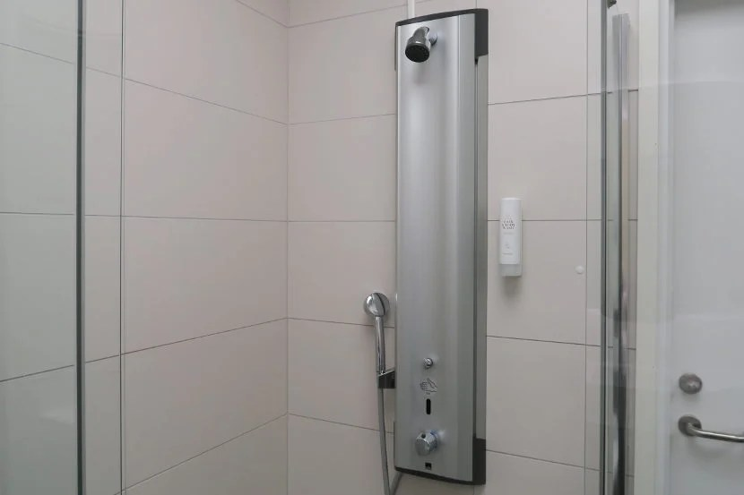 Individual shower cabinets provided shampoo, conditioner, a shaving kit and more.