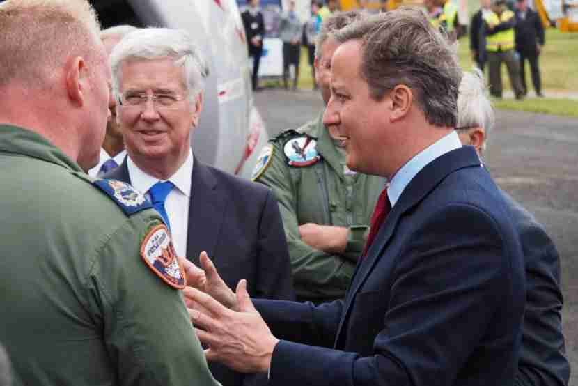 David Cameron chats with members of a UK crew for the P-8A Poseidon patrol jet.