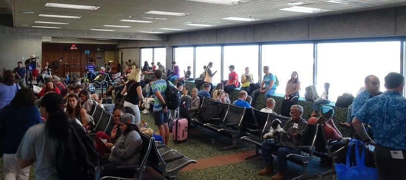 Passengers wait for the next flight.