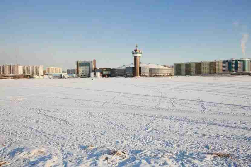 """Yakutsk is a frozen tundra most of the year. Image courtesy of <a href=""""http://www.shutterstock.com/pic-349092833/stock-photo-winter-urban-landscape-with-a-lake-on-a-clear-day.html?src=xyTDELuVUND8QmzbTNiIUQ-1-3"""" target=""""_blank"""">Shutterstock</a>."""