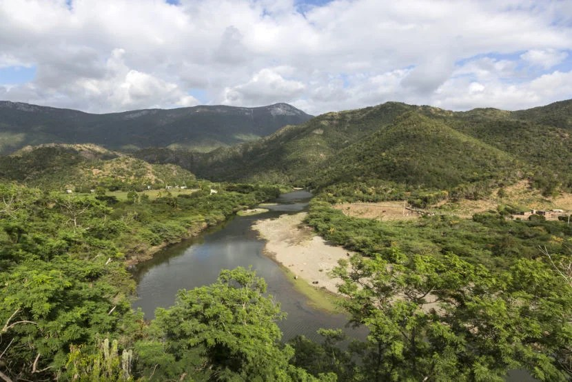 """Baconao Park and Biosphere Reserve is a beautiful, protected area located just outside Santiago de Cuba. Photo courtesy of <a href=""""http://www.shutterstock.com/dl2_lim.mhtml?src=xkXOzUqtcQ38MibMy8_4WA-1-1&clicksrc=download_btn_inline&id=377096026&size=medium_jpg&submit_jpg="""" target=""""_blank"""">Shutterstock</a>."""