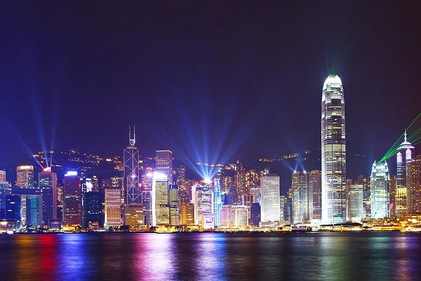 "Hong Kong comes alive every night at 8:00pm. Image courtesy of <a href=""http://www.shutterstock.com/pic-158201477/stock-photo-hong-kong-skyline-at-night.html?src=TeEmNEbkxo84FcZXxjNeAA-1-30"">Shutterstock</a>."