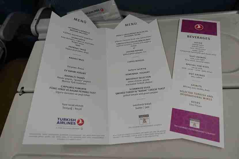 Economy class passengers get food menus.