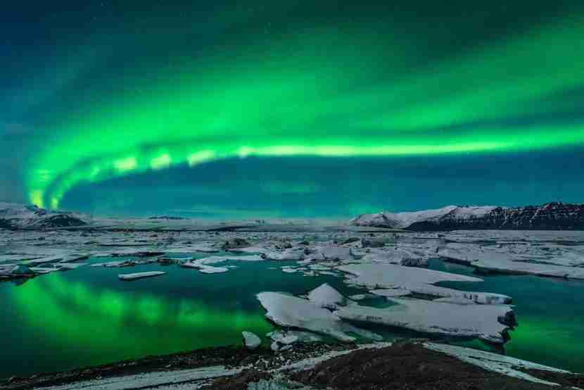 "The northern lights are visible most of the year in Northern Alaska. Image courtesy of <a href=""http://www.shutterstock.com/pic-143438332/stock-photo-spectacular-auroral-display-over-the-glacier-lagoon-jokulsarlon-in-iceland.html?src=undefined-1-0"" target=""_blank"">Shutterstock</a>."