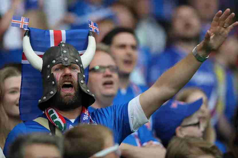 "An Icelandic football fan supports his team during the Euros. Image courtesy of <a href=""http://www.shutterstock.com/pic-437238130/stock-photo-saint-etienne-francejune-2016-fans-and-supporterson-the-stands-in-football-match-of-euro-2016-in-france-between-portugal-vs-iceland-at-the-stade-geoffroy-guichard-on-june-142016-in-sa.html?src=jxYYhQlh2shfh4pGPliEhQ-1-67"">Shutterstock</a>."