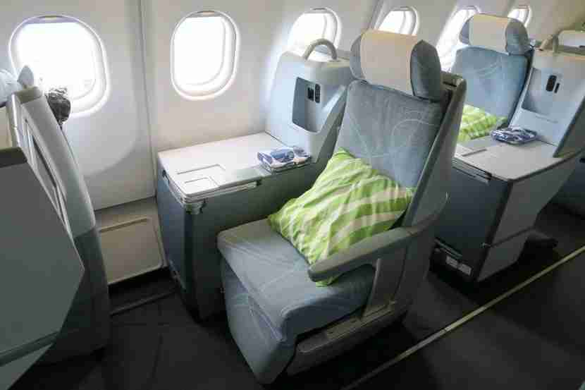 The right side of the business class cabin features staggered one-seat rows.