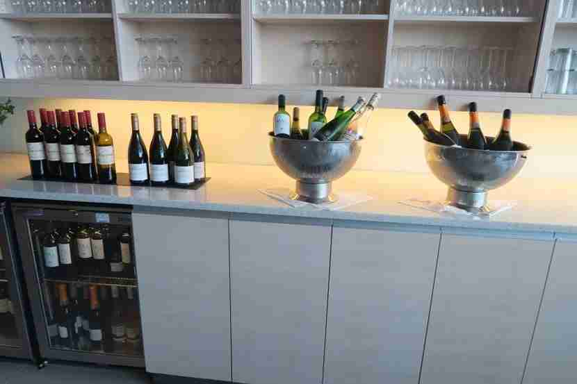 In order to keep up with the busy lounge, the lounge left out many bottles of each type of wine and champagne.