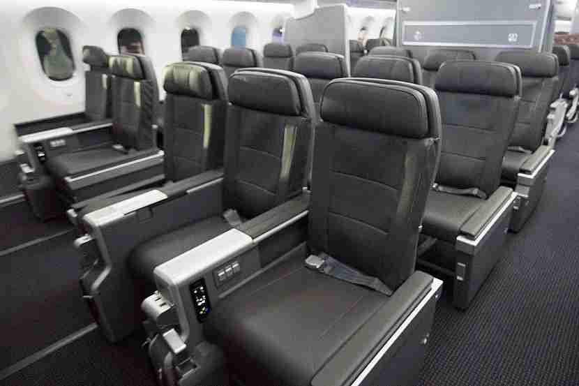 Use airline fee credits to upgrade to premium economy cabins, like the new one on AA