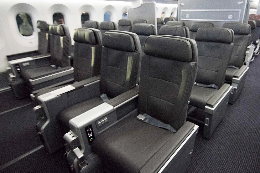 Use airline fee credits to upgrade to premium economy cabins, like the new one on AA's 787-9. Photo courtesy of American Airlines.