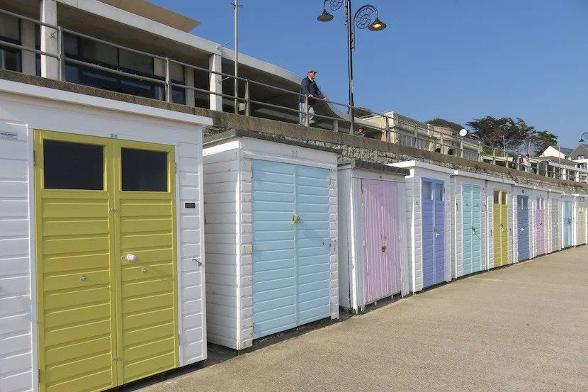 Huts along the beach in Lyme Regis.
