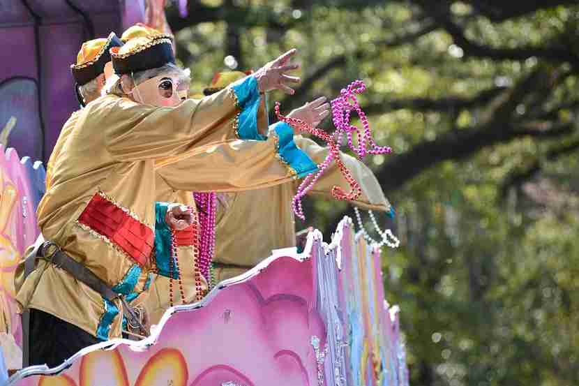 "Catching ""throws"" during parades is a must-do activity for both adults and kids during Mardi Gras. Image courtesy of Shutterstock."