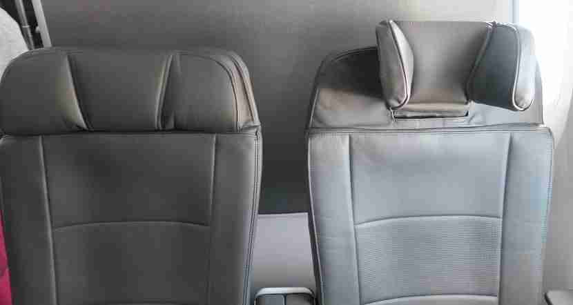 Premium economy headrest arranged at their least and most extended.