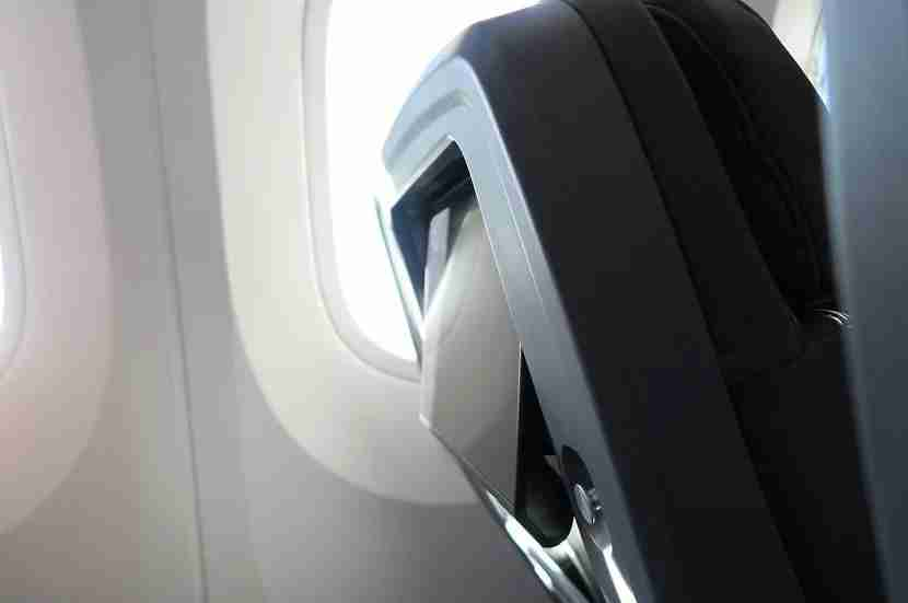 In premium economy, the screens have extra tilt to counter the extra seat recline.