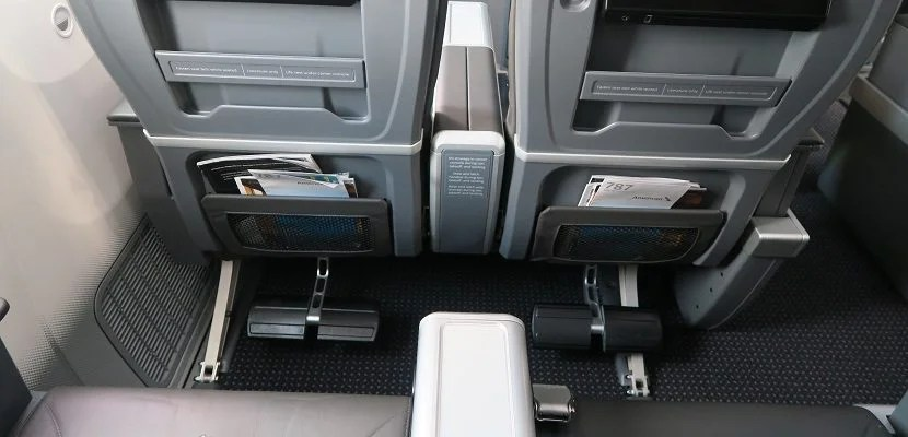 Simple footrest fold out from the seats in front of rows 10 and 11.