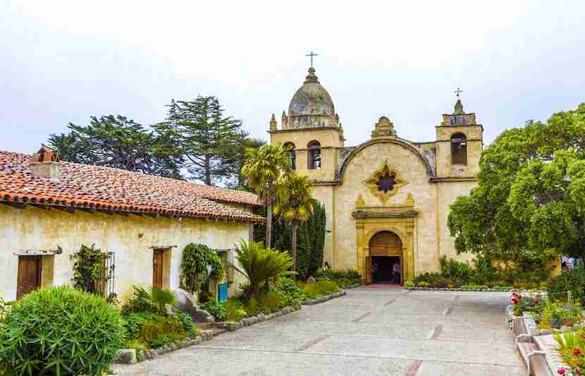 """Visit the San Carlos Borromeo de Carmelo Mission for its beauty and its history. Image courtesy of <a href=""""http://www.shutterstock.com/pic-122850025/stock-photo-carmel-mission-in-northern-california-founded-in-1770.html?src=ulZXq4TrSkZiZufelE3Gnw-1-6"""">Shutterstock</a>."""