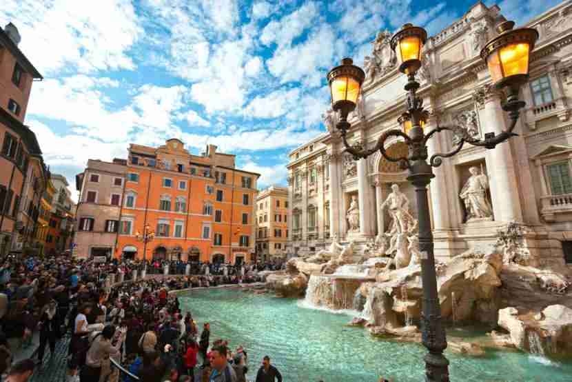 """All these tourists tossing coins into the fountain are actually supporting a charitable cause. Image courtesy of <a href=""""http://www.shutterstock.com/dl2_lim.mhtml?src=KkP95SPN0JYs9shkZqixbg-1-24&amp;id=127897592&amp;size=medium_jpg"""">Shutterstock</a>."""