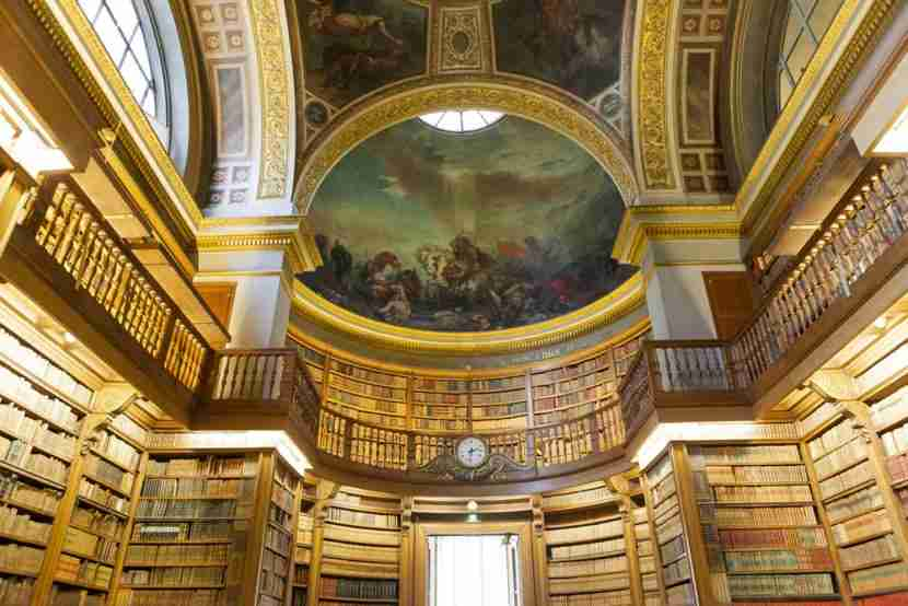 """The library at the Assemblée Nationale, which features painted ceilings by Delacroix. Image courtesy of <a href=""""http://www.shutterstock.com/dl2_lim.mhtml?src=PzLPpkEF2fsLGFObYE6doQ-1-4&amp;id=155492078&amp;size=medium_jpg"""">Shutterstock</a>."""