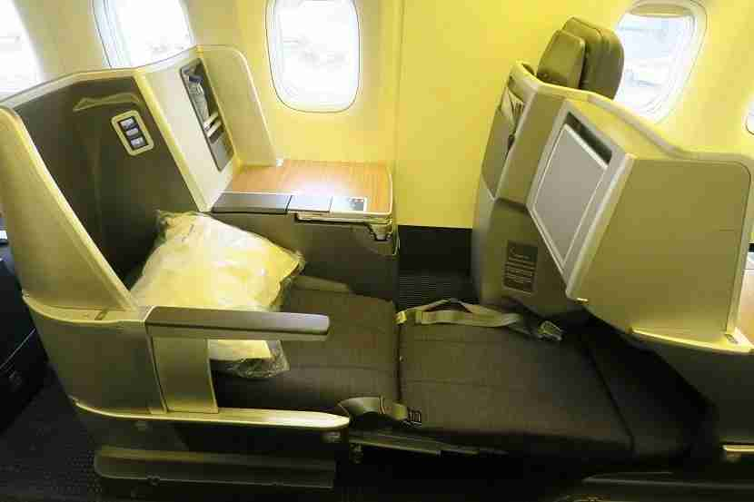 While seemingly not a full 180°, the seats recline into a nearly-flat bed.