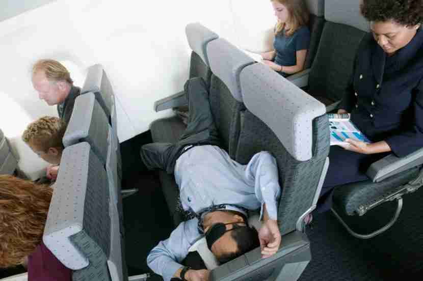 All you need to sleep soundly on the plane are an eye mask and some good earplugs. Image courtesy of ColorBlind Images via Getty.
