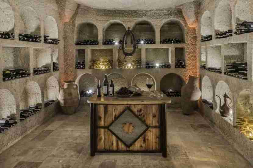 Stay for a tipple in the cave wine cellar. Image courtesy of the Aydlini Cave Hotel.