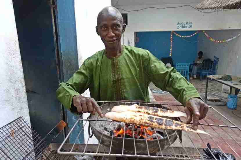 I chatted about boats with this local and then headed over to his restaurant, where he prepared a meal of fresh fish for me. Senegal is a safe and friendly country. Image by the author.