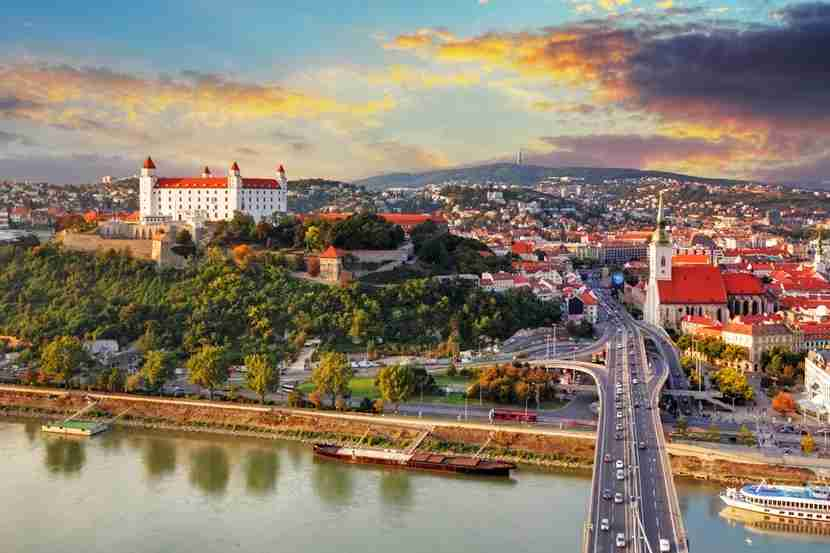 "<em>Bratislava is petite yet picturesque. Image courtesy of <a href=""http://www.shutterstock.com/pic-158023259/stock-photo-bratislava-at-sunset-aerial-view-slovakia.html?src=D5jwSpRkiQMxmyx9IawHWA-1-1"" target=""_blank"">Shutterstock</a>.</em>"