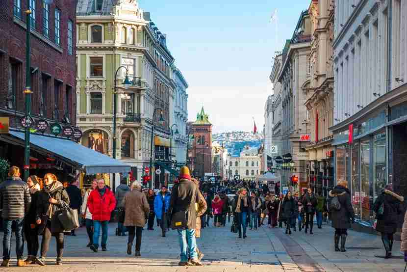 "<em>Take a stroll through downtown Oslo. Image courtesy of <a href=""http://www.shutterstock.com/pic-336944969/stock-photo-oslo-norway-january-29-people-walking-along-the-street-in-oslo-downtown-in-sunny-winter-day-taken-in-oslo-january-29-2015.html?src=r-64iidItZRkfWKV4Febcg-1-68"" target=""_blank"">Shutterstock</a>.</em>"