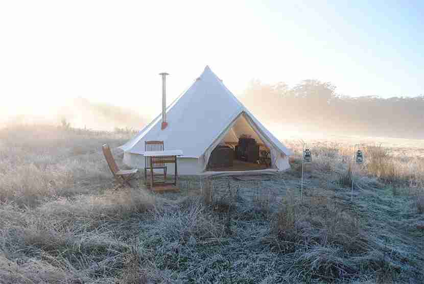 No need to stay at a five-star hotel to get luxury service. Pop a bottle of Champagne in the countryside glamping near Daylesford. Image courtesy of Cosy Tents