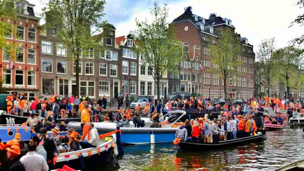In Amsterdam, the Konigsdag parades go down canals, not streets. Image courtesy of Tobias Poel / EyeEm via Getty Images.