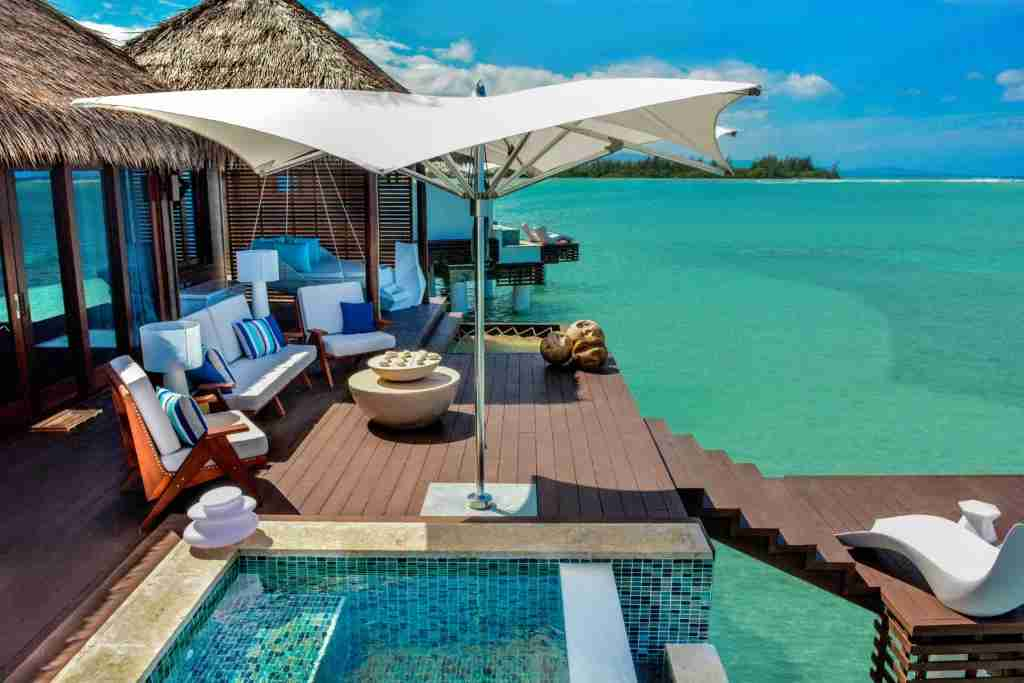 The pool and deck of an overwater villa at Sandals Royal Caribbean - Montego Bay, Jamaica. Image courtesy of Sandals Resorts.