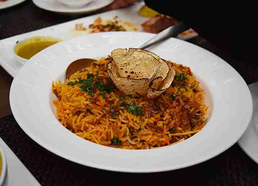Kathal (or jackfruit biryani) eaten with a side of yogurt. Image courtesy of My Annoying Opinions via Getty Images.
