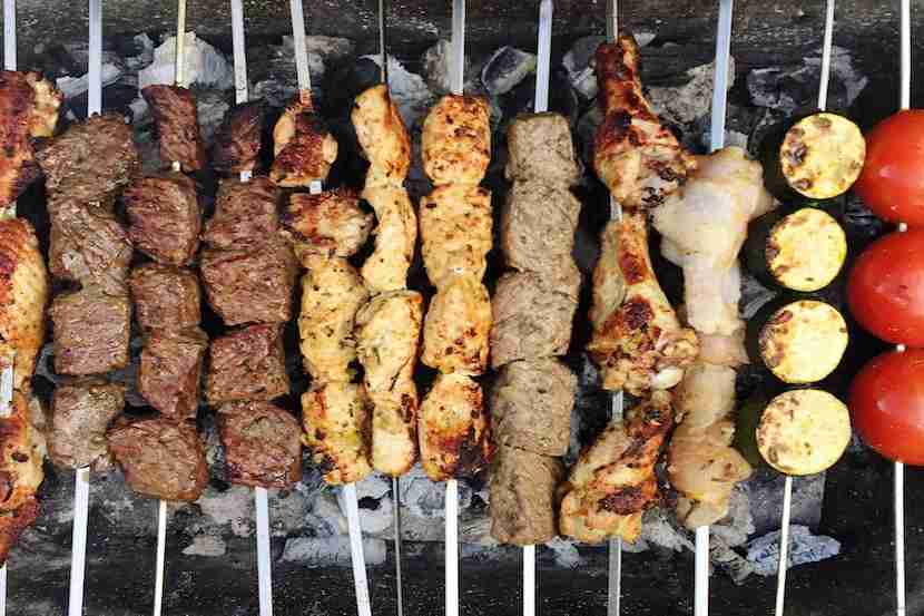 Skewered kebabs being cooked in a tandoor. Image courtesy of Zuzana Gajdosikova viaGetty Images.