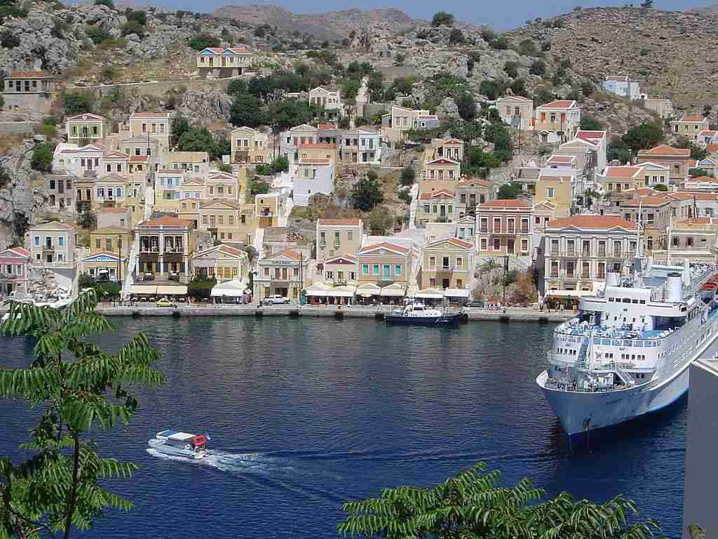 The colorful houses of Symi, Greece. Image courtesy of Scintella via Wikimedia Commons.