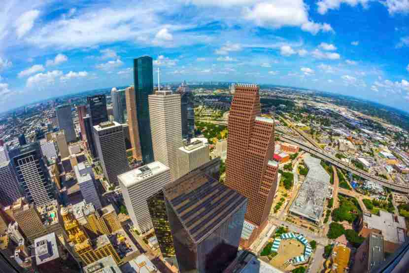 aerial of modern buildings in downtown Houston in daytimeMeinzahn via Getty Images.
