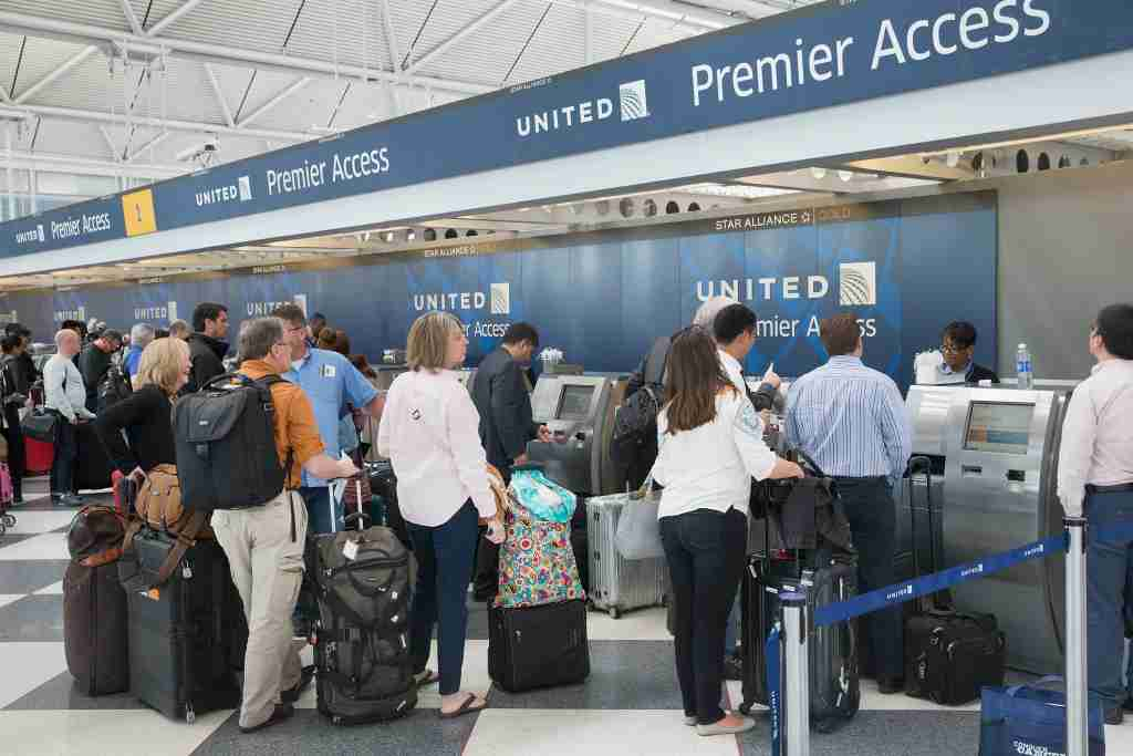 CHICAGO, IL - JUNE 02: Passengers check-in for flights with United Airlines at O