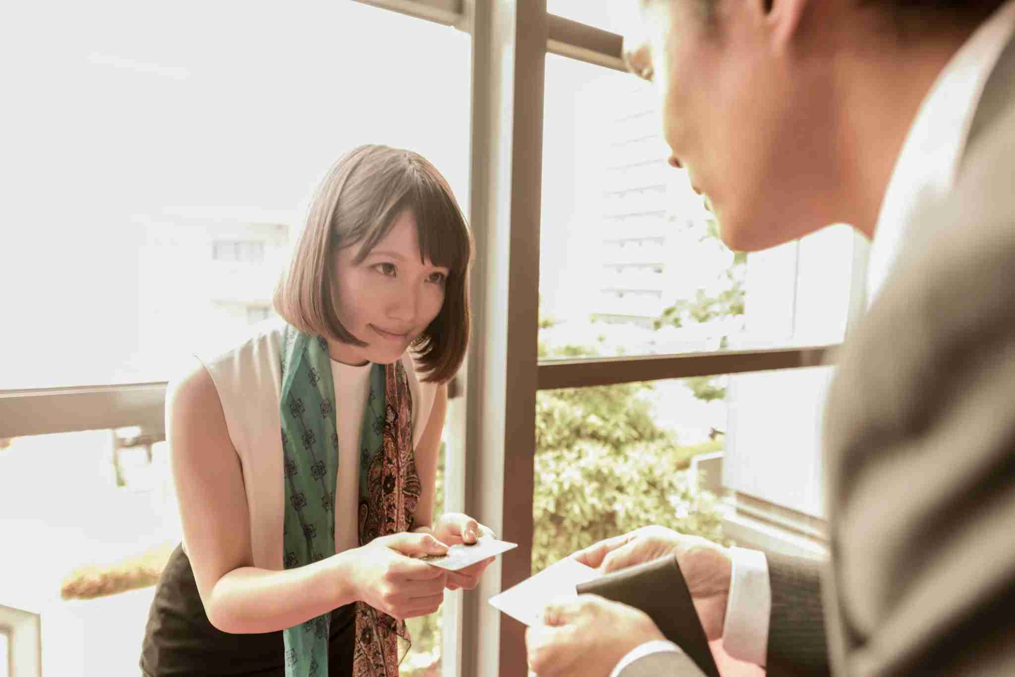 And always use both hands when exchanging business cards in Japan. Image courtesy of Johnny Greig via Getty Images.