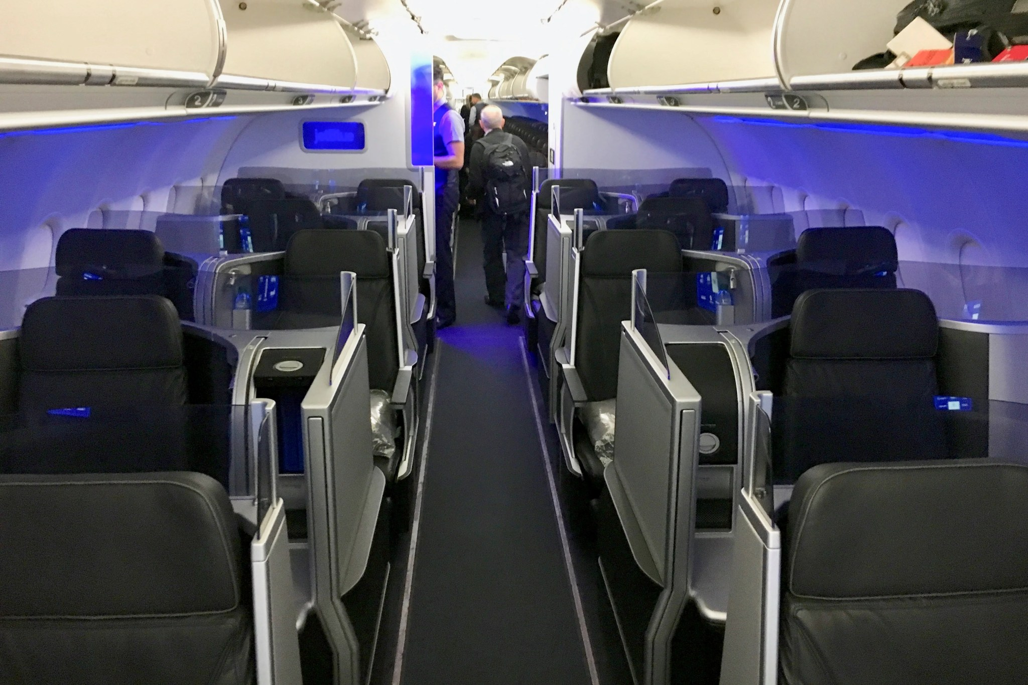 According to SeatGuru, Sun Country's 39 inches of seat pitch in first lands in between what you'll find aboard the 's of Delta (38″) and American (40″ to 42″) with average domestic first class width. All seats in this cabin have good recline, adjustable headrests and a generous center console.