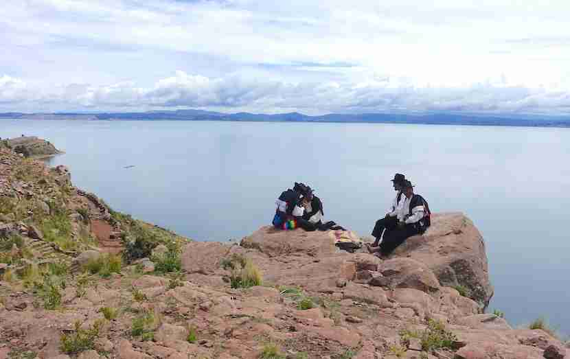 Locals take a break for lunch on Taquile Island.