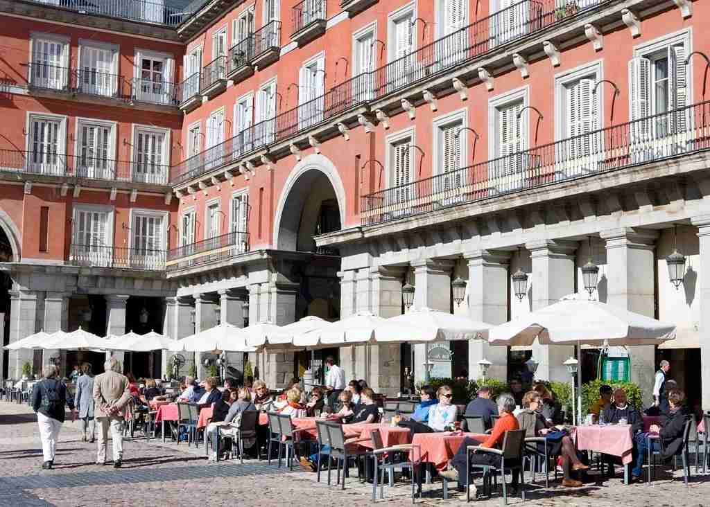 Outdoor terraces in the Plaza Mayor offer some respite from the neverending Madrid sun. Image courtesy of Madrid Destino Cultura Turismo y Negocio.