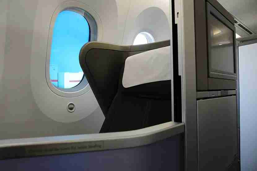 Every Club World seat has a neighbor sitting adjacent. Great for couples, not so much for solo or business travellers. There is a privacy screen, however.