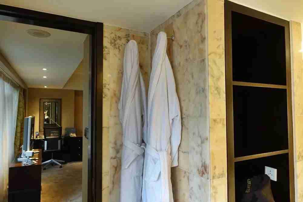 Bathrobes, hair dryer and an inconvenient place for a plug.